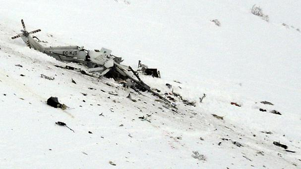 The wreckage of a helicopter lies in the snow after crashing in the Campo Felice ski area (AP)