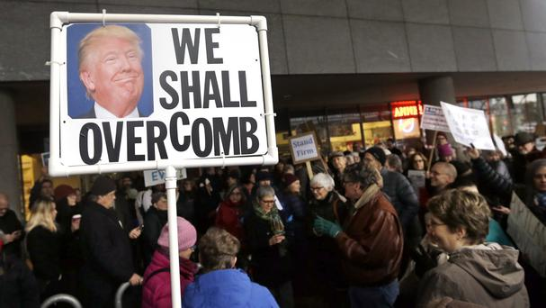 A banner ridicules Donald Trump during a demonstration outside the World Trade Centre in Portland, Oregon (AP)