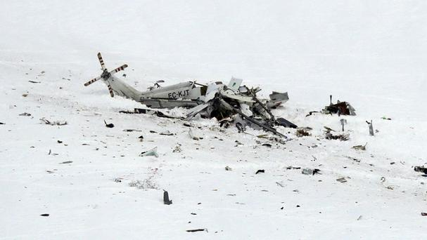 The wreckage of the helicopter lies in the snow after crashing in the Campo Felice ski area (AP)