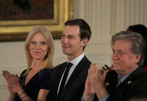 Kellyanne Conway, Jared Kushner and Steve Bannon applaud before being sworn in by Vice President Mike Pence in Washington REUTERS/Carlos Barria