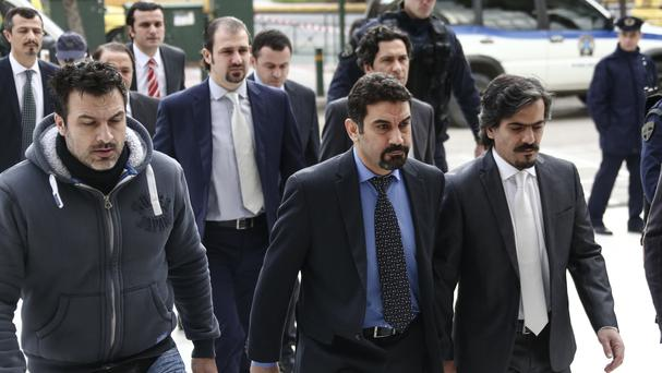 The officers appeared at Greece's Supreme Court in a closely-watched extradition hearing (AP)