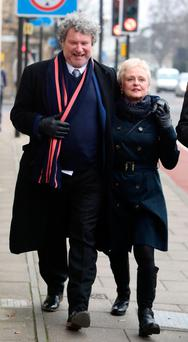 Comedian Rory McGrath, with his wife Nicola, leaving Huntingdon Magistrates Court where avoided jail after admitting harassing a married former lover for 14 months. Photo: PA