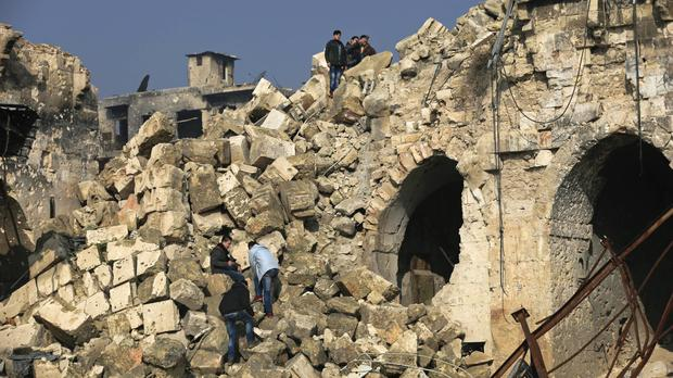 The heavily-damaged Great Mosque of Aleppo, as the UNs' humanitarian chief accused the Syrian government of blocking aid to hundreds of thousands of the country's neediest people (AP/Hassan Ammar)