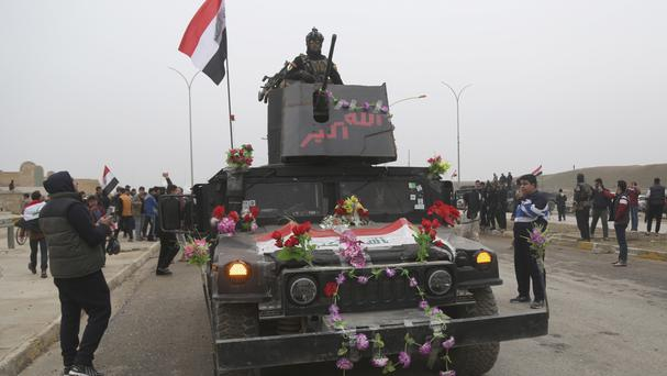 Iraqi special forces troops parade to celebrate the fully liberation of the eastern side of Mosul (AP)