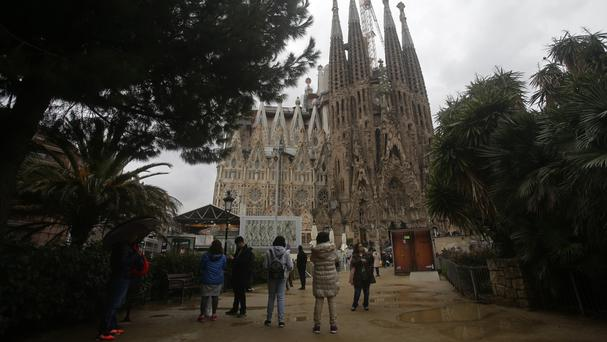 Tourists gather in front of the Sagrada Familia church, designed by architect Antoni Gaudi, in Barcelona (AP/Manu Fernandez)