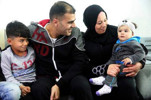 DESPERATE SITUATION: Syrian refugee Ammar Sawan with his wife and the two youngest of their four children