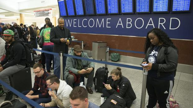 Delta passengers wait at Atlanta's Hartsfield-Jackson International Airport after Delta Air Lines grounded all domestic flights due to automation issues (AP)