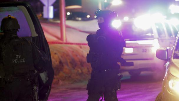 Police at the scene of the shooting (The Canadian Press/AP)