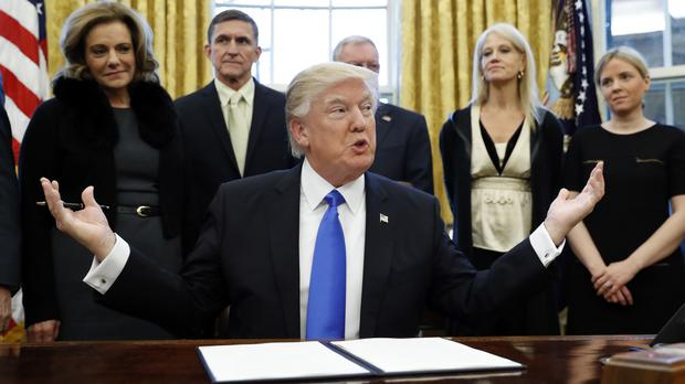Donald Trump in the White House with members of his team (AP/Alex Brandon)