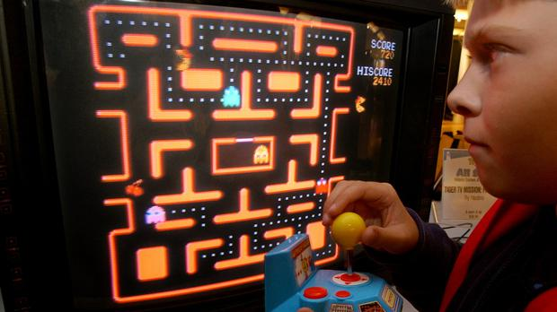 A boy plays Pac-Man (AP Photo/Richard Drew, File)