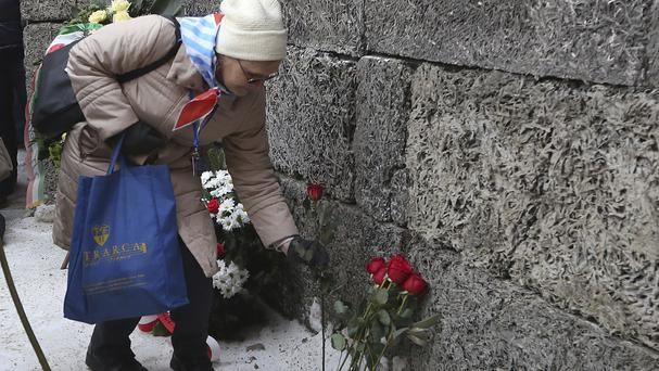 A holocaust survivor commemorates the people killed by the Nazis at the former Auschwitz Nazi death camp (AP)
