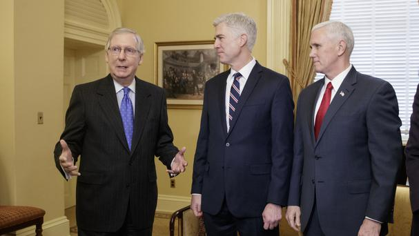 Neil Gorsuch (centre) is joined by Vice President Mike Pence (right) as they meet Senate majority leader Mitch McConnell on Capitol Hill (AP)