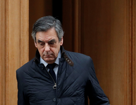 French presidential candidate François Fillon leaves his home in Paris yesterday morning Photo: REUTERS/Christian Hartmann