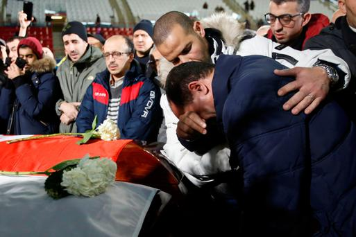 Mourners pay their respects during a funeral ceremony for three of the victims of the deadly shooting at the Quebec Islamic Cultural Centre. Photo: Getty Images