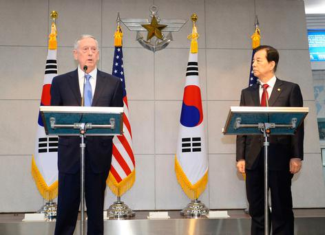 US Defense Secretary James Mattis (L) speaks with South Korean Defense Minister Han Min-Koo (R) before their meeting at the headquarters of the defense ministry in Seoul