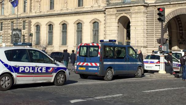 Police near the Louvre Museum in Paris where a French soldier shot and seriously injured a man in a shopping area beneath the museum