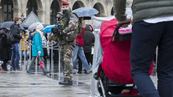 A French soldier patrols in the courtyard of the Louvre museum in Paris on Saturday (AP Photo/Kamil Zihnioglu)