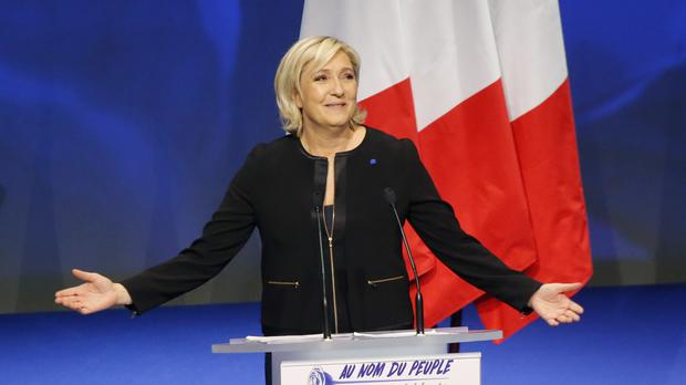 Marine Le Pen addresses her party's conference in Lyon