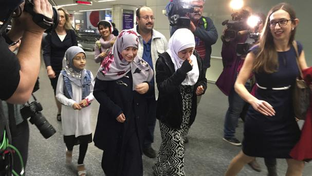 Eman Ali and her father, Ahmed Ali after they arrived at San Francisco International Airport (AP Photo/Olga Rodriguez)