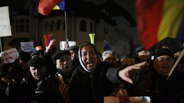 People take part in a protest in Bucharest (AP)