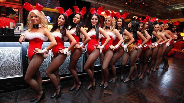 Waitresses pose inside the Playboy Club at the Sands Casino in Macau in 2010 (AP)