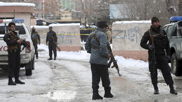 Security personnel stand guard at the site of a suicide attack on the Supreme Court in Kabul (Massoud Hossaini/AP)