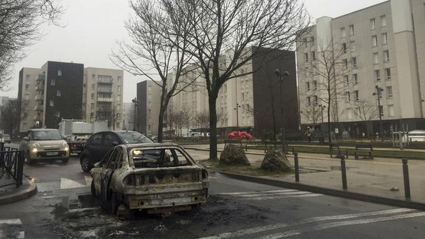 The remains of a car burnt by protesters on Monday night in Aulnay-sous-Bois, north of Paris (Alex Turnbull/AP)