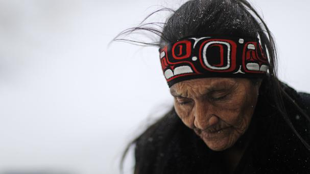 Grandma Redfeather of the Sioux Native American tribe walks in the snow to get water at the Oceti Sakowin camp, where protests took place against the Dakota Access oil pipeline (AP)