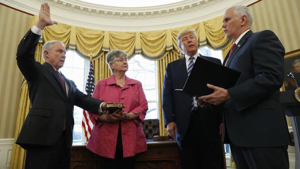 President Donald Trump watches as Vice President Mike Pence administers the oath of office to Attorney General Jeff Sessions (Pablo Martinez Monsivais/AP)
