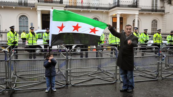 Protesters demonstrate about the bloody conflict outside the Syrian embassy in Belgrave Square, central London