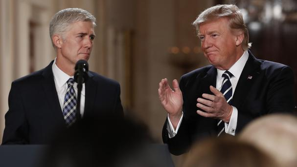 Donald Trump applauds as he stands with Judge Neil Gorsuch after announcing him as his nominee for the Supreme Court (AP)