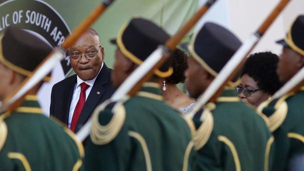 South African President Jacob Zuma reviews the guard of honour at Parliament in Cape Town. (AP/Schalk van Zuydam)