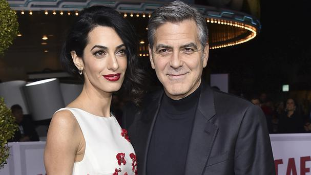 Amal and George Clooney are said to be expecting twins in June (Invision/AP)