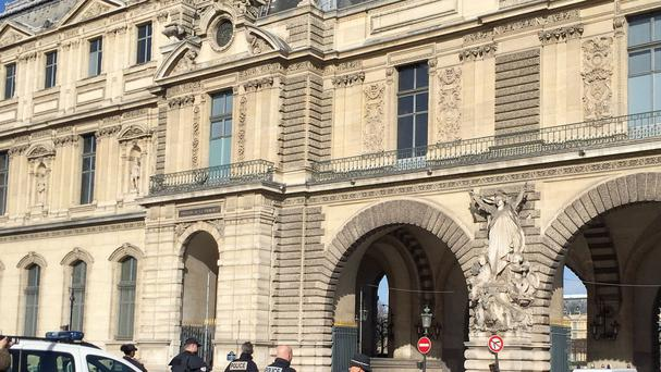 French police close to the Louvre Museum in Paris following the attack