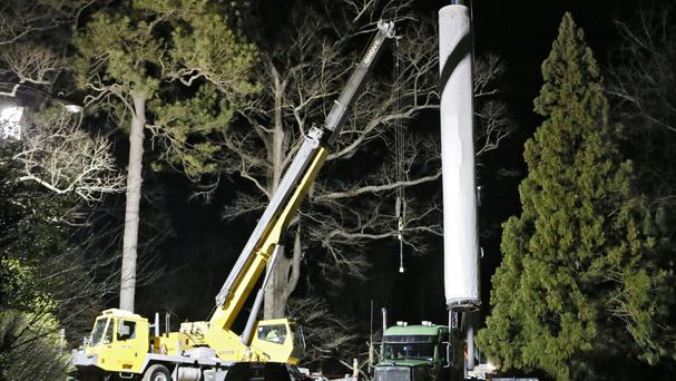 A crane lowers a portion of the Cyclorama, one of the world's largest paintings, on to the lorry (Atlanta Journal-Constitution/AP)