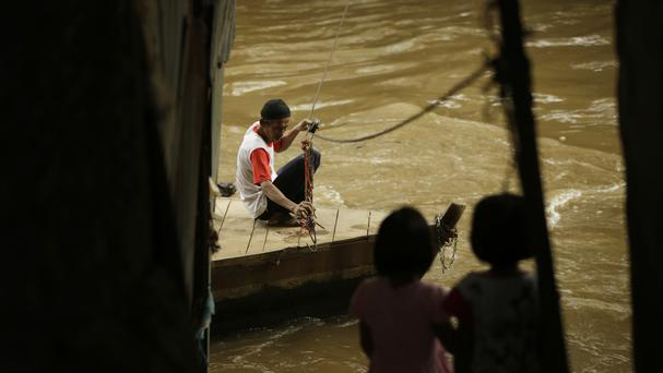 Heavy rain in Indonesia has caused flooding that has affected 40,000 people (AP/Achmad Ibrahim)