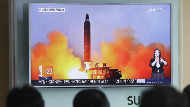 People in Seoul watch TV news footage of a North Korean ballistic missile launch (AP)