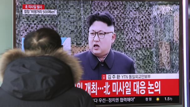 A South Korean TV news programme showing North Korean leader Kim Jong Un announces the missile launch (AP)