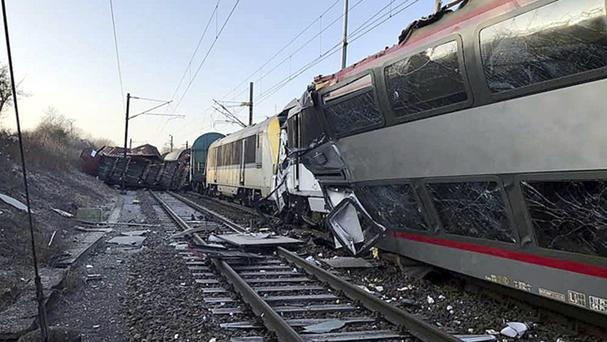 The wreckage of a passenger train and a freight train after they collided in Bettembourg (Luxembourg Police Grand Ducale/AP)