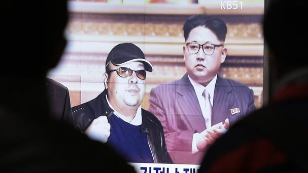 A TV screen at Seoul Railway Station shows pictures of North Korean leader Kim Jong Un, right, and his older brother Kim Jong Nam (AP)