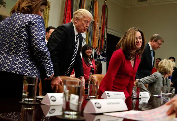 President Donald Trump pulls out a chair for former principal Aimee Viana prior to a parent-teacher session in the White House yesterday. Photo: Alex Wong/Getty Images
