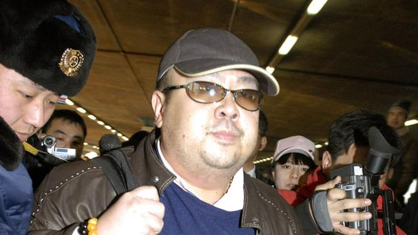 Pictured in February 2007, a man believed to be Kim Jong Nam is surrounded by the media at Beijing airport (Kyodo News via AP)