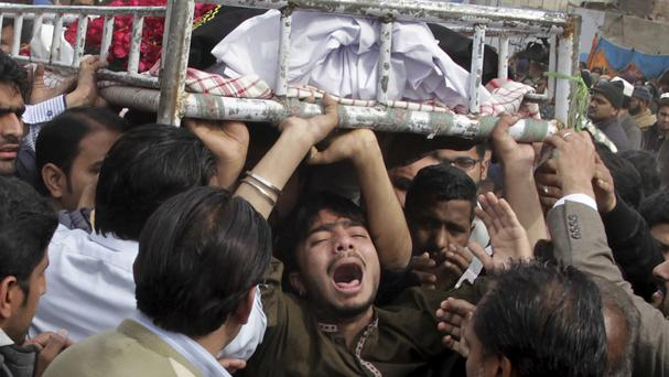 People mourn the death of a family member who was killed in a bomb attack in Lahore, Pakistan, on Monday (AP Photo/KM Chaudary)