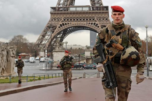 French paratroopers patrol near the Eiffel tower in Paris