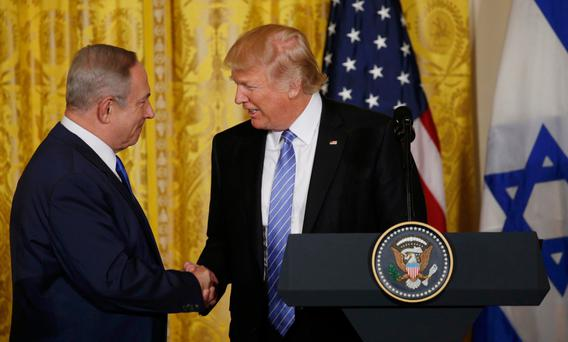 US President Donald Trump greets Israeli Prime Minister Benjamin Netanyahu after a joint news conference at the White House. Photo: Reuters/Kevin Lamarque