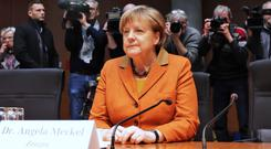 German Chancellor Angela Merkel arrives for questioning at an investigation committee of the German federal parliament (Michael Sohn/AP)
