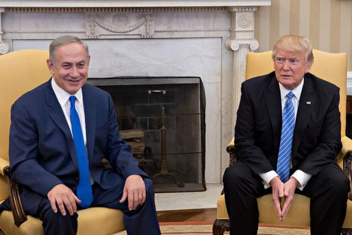 US President Donald Trump (R) sits with Israel Prime Minister Benjamin Netanyahu in the Oval Office of the White House this week. Photo: Getty Images