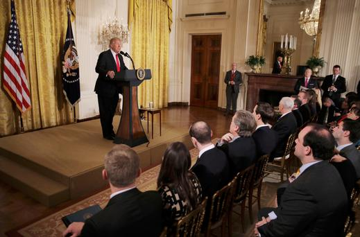 President Donald Trump speaks during a news conference yesterday in the East Room of the White House. Photo: Reuters