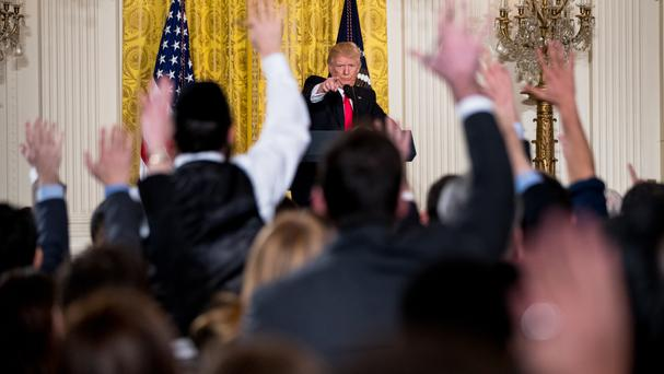 President Donald Trump calls on members of the press during a news conference at the White House (AP Photo/Andrew Harnik)
