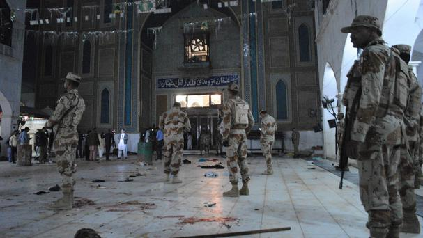Pakistani paramilitary soldiers on guard after a deadly suicide attack at a shrine in Sehwan (AP Photo/Pervez Masih)